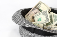 stock-photo-56847514-passing-the-hat-black-and-white-hat-with-cash
